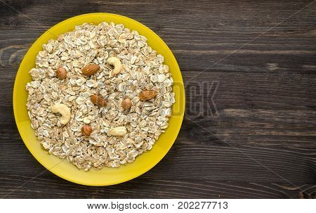 Muesli With Nuts. Muesli On A Wooden