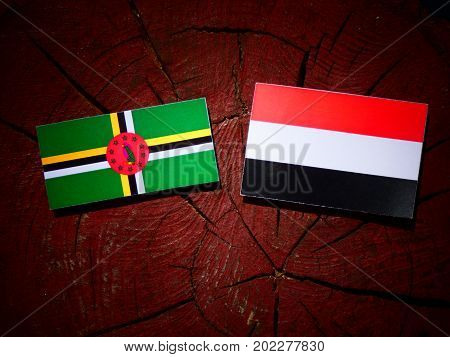 Dominica Flag With Yemeni Flag On A Tree Stump Isolated