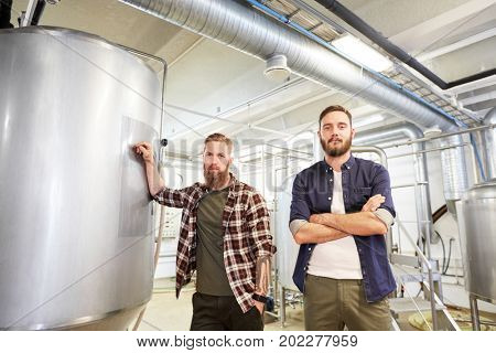production, business and people concept - men at craft brewery or non-alcoholic beer plant