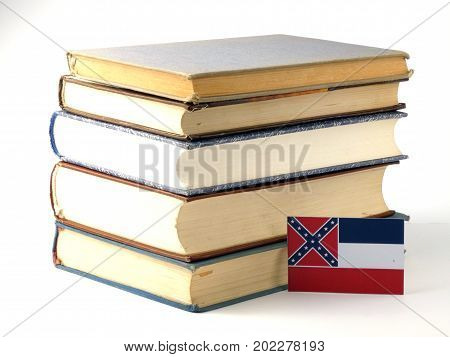 Mississippi Flag With Pile Of Books Isolated On White Background