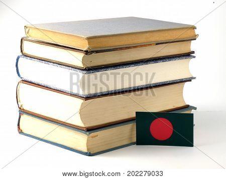 Bangladesh Flag With Pile Of Books Isolated On White Background