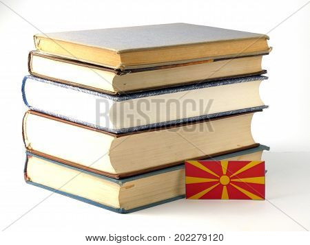 Macedonian Flag With Pile Of Books Isolated On White Background