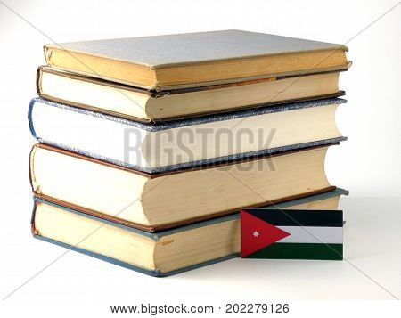 Jordanian Flag With Pile Of Books Isolated On White Background