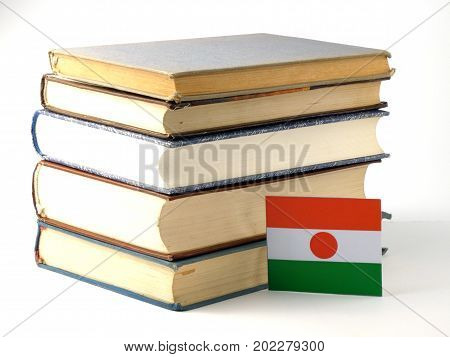 Niger Flag With Pile Of Books Isolated On White Background