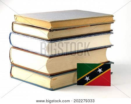 Saint Kitts And Nevis Flag With Pile Of Books Isolated On White Background