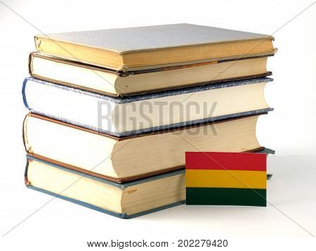 Bolivian Flag With Pile Of Books Isolated On White Background
