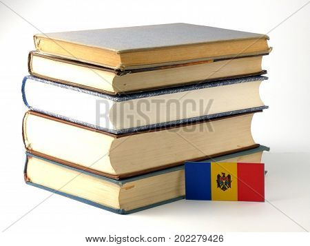 Moldovan Flag With Pile Of Books Isolated On White Background