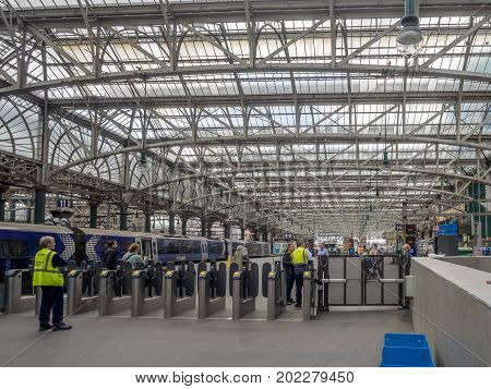 GLASGOW, SCOTLAND - JULY 20: Inside Central Station with unidentified people on July 20, 2017  in Glasgow, Scotland. Glasgow Central is the major mainline rail terminus for Glasgow.