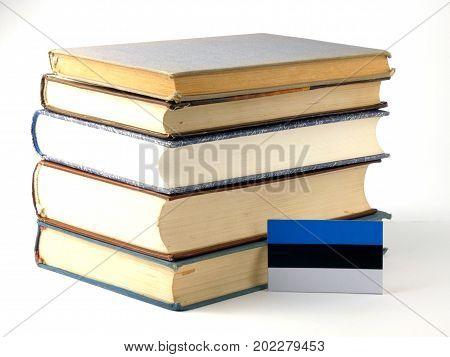Estonia Flag With Pile Of Books Isolated On White Background