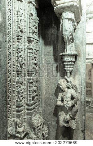 JAISALMER RAJASTHAN INDIA - MARCH 09 2016: Vertical picture of marble stone carving on the wall of Jain Temples inside the fort of Jaisalmer in India.