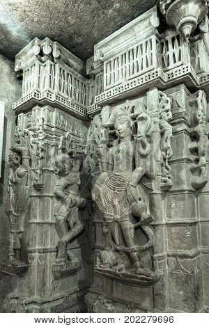 JAISALMER RAJASTHAN INDIA - MARCH 09 2016: Vertical picture of beautiful marble stone carving on the wall of Jain Temples inside the fort of Jaisalmer in India.