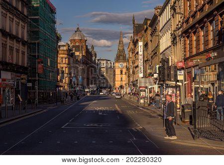 GLASGOW SCOTLAND - JULY 20: Argyle Street in central Glasgow at sunset on July 20, 2017 in Glasgow, Scotland. Argyle Street is a main commercial street in the city.