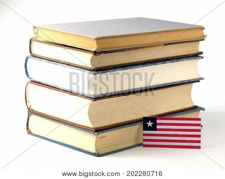 Liberian Flag With Pile Of Books Isolated On White Background