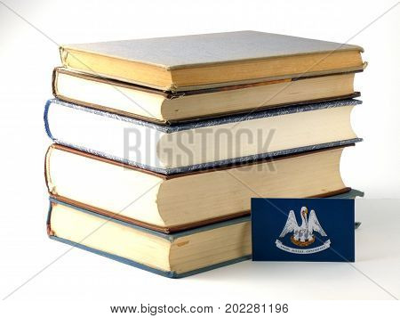 Louisiana Flag With Pile Of Books Isolated On White Background