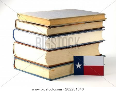 Texas Flag With Pile Of Books Isolated On White Background