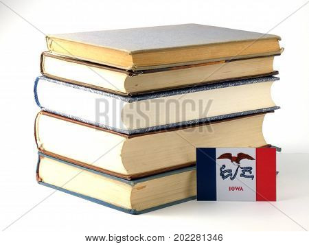 Iowa Flag With Pile Of Books Isolated On White Background