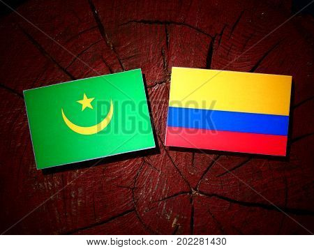 Mauritania Flag With Colombian Flag On A Tree Stump Isolated