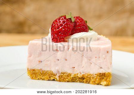 Homemade strawberry cheesecake on white dish, Piece of cheesecake