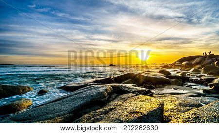 Sunset over the horizon of the Atlantic Ocean at Camps Bay near Cape Town South Africa on a nice winter day