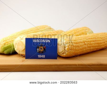 Wisconsin Flag On A Wooden Panel With Corn Isolated On A White Background