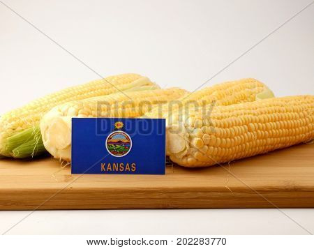 Kansas Flag On A Wooden Panel With Corn Isolated On A White Background