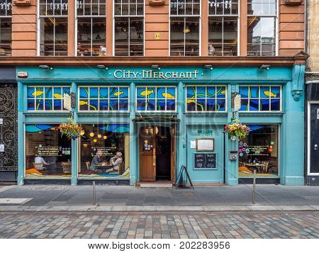 GLASGOW, SCOTLAND - JULY 21: City Merchant pub on July 21, 2017 in Glasgow, Scotland. City Merchant pub is a popular pub and whisky bar across the street from George Square.