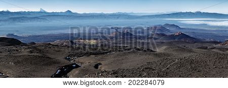 Panorama volcano landscape of Kamchatka Peninsula: series of cinder cones and lava fields of fissure eruptions Plosky Tolbachik Volcano. Russian Far East Kamchatka Klyuchevskaya Group of Volcanoes.
