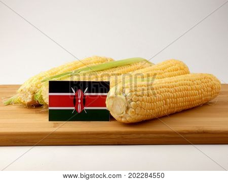 Kenyan Flag On A Wooden Panel With Corn Isolated On A White Background