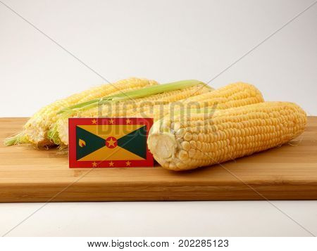 Grenada Flag On A Wooden Panel With Corn Isolated On A White Background