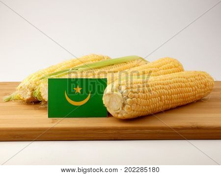Mauritania Flag On A Wooden Panel With Corn Isolated On A White Background