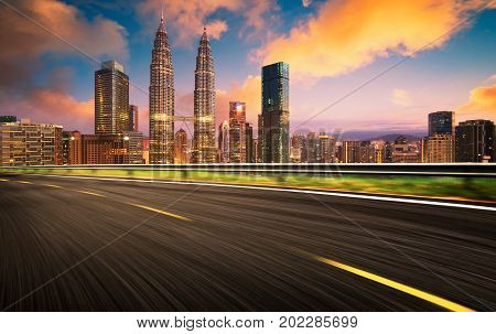 Speedy motion forward flyover with beautiful Kuala Lumpur city skyline Sunset scene .