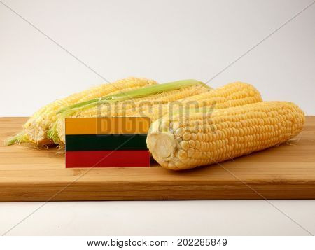 Lithuanian Flag On A Wooden Panel With Corn Isolated On A White Background