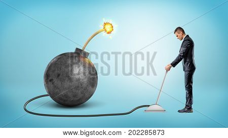 A small businessman turning a metal lever connected to a large iron bomb with a lit fuse. Trouble making. Crisis management. Problem neutralization.