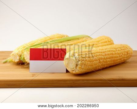 Indonesian Flag On A Wooden Panel With Corn Isolated On A White Background