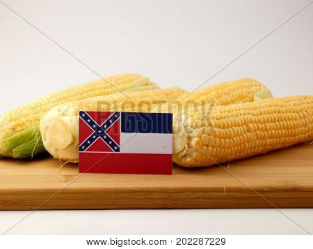 Mississippi Flag On A Wooden Panel With Corn Isolated On A White Background