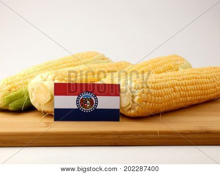 Missouri Flag On A Wooden Panel With Corn Isolated On A White Background