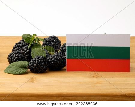 Bulgarian Flag On A Wooden Panel With Blackberries Isolated On A White Background