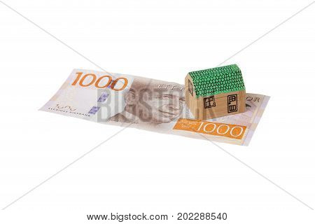 Stockholm Sweden - April 25 2016: One small wooden hose with green roof on a Swedish 1000 krona banknote isolated on white background.