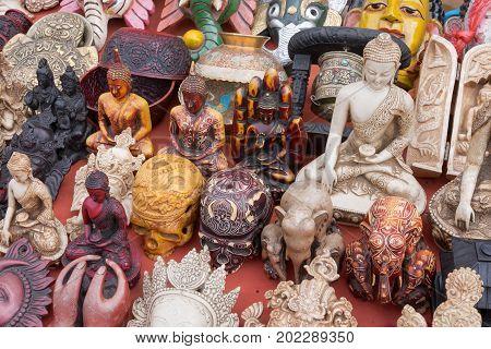 Souvenirs statuettes Souvenirs statuettes figurines and handicraft at flea market Kathmandu Nepal