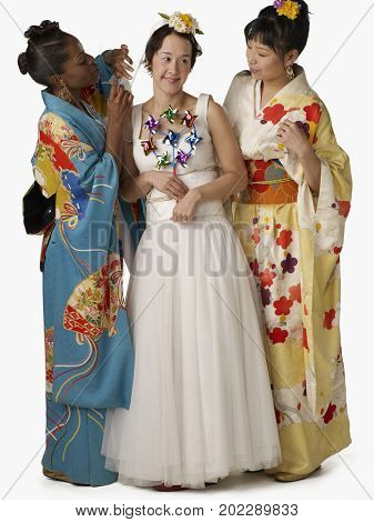 Asian bride with bridesmaids in traditional clothing