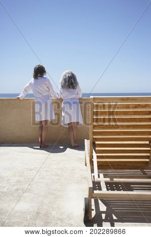 Friends looking over balcony at resort