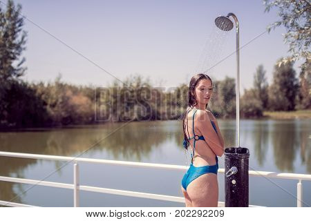 One Young Adult Woman Model Smiling Enjoying, Standing, Water Showering Shower, Eyes Closed, Wet Lon