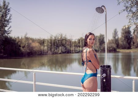 One Young Adult Woman Model Smiling Enjoying, Standing, Water Showering Shower, Looking To Camera, W