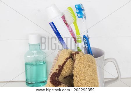 good morning health teeth in oral cavity toothbrush with mouthwash on white in bathroom