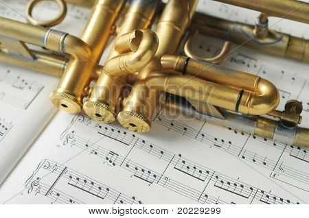 beautiful golden trumpet on sheet music