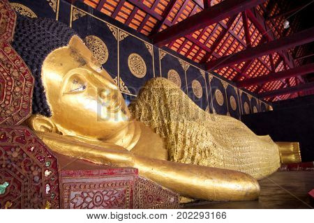 Reclining Buddha (Sleep Buddha) at Wat Chedi Luang in Chiang Mai, Thailand. Wat Chedi Luang is one of the most popular famous tourist attraction temples in Chiang Mai.