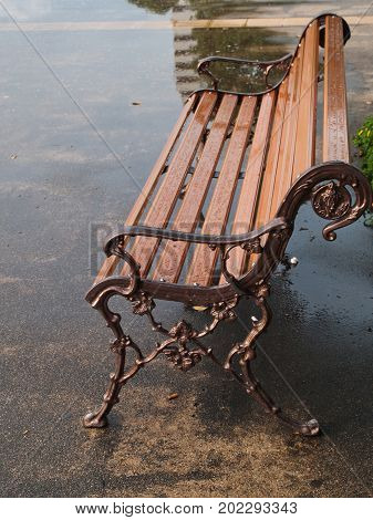 Rainy summer day in the park. Bench in the park on raining day