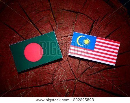 Bangladesh Flag With Malaysian Flag On A Tree Stump Isolated