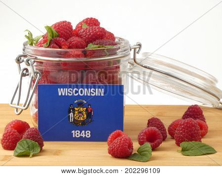 Wisconsin Flag On A Wooden Panel With Raspberries Isolated On A White Background