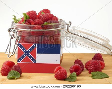 Mississippi Flag On A Wooden Panel With Raspberries Isolated On A White Background